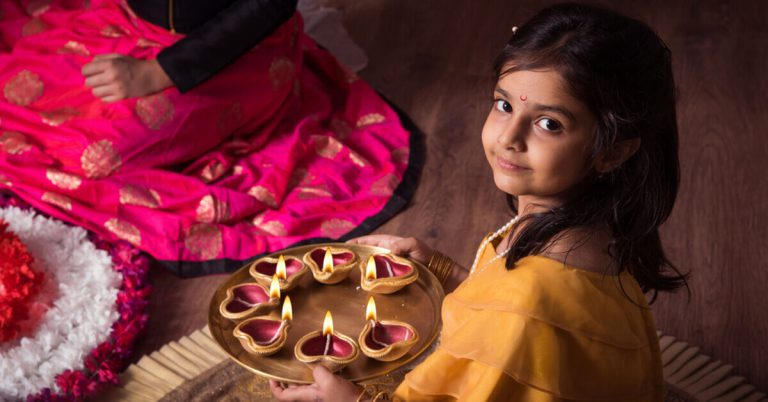 A girl with rangoli during Deepavali