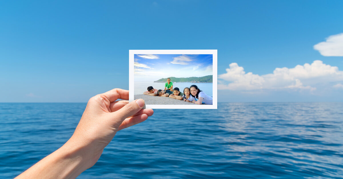 A picture of a family on travel against a seascape