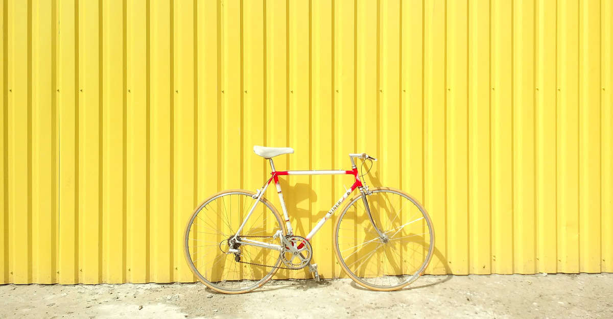 Cycling in Singapore, bicycle against yellow wall
