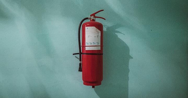 Image of fire extinguisher to symbolise emergency funds