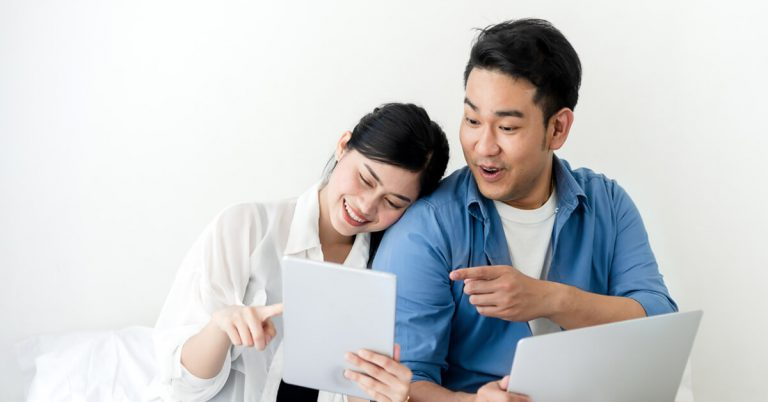 A couple spending time online together to avoid being bored at home