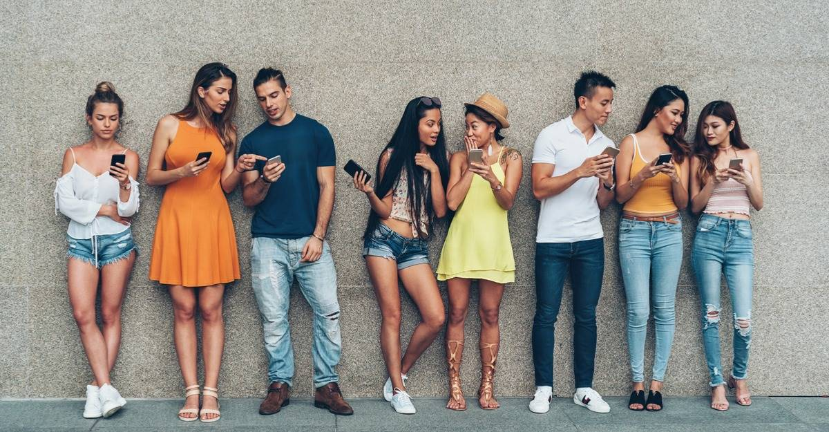 Young adults with mobile devices